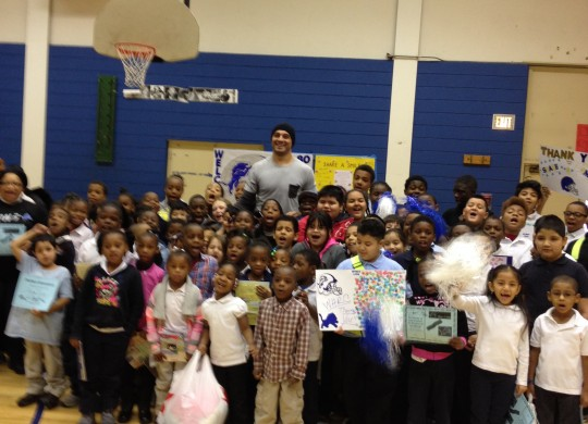 Joseph Fauria delivers warm coats and some smiles